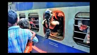 Funny BigC  Funny indian women using emergency exit window to catch a place in train