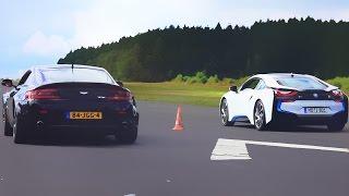 شاهد: BMW i8 تنافس أستون مارتن Vantage في سباق سحب