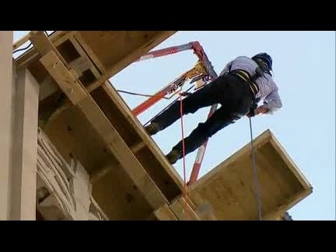 Stan Boney rappels down Metropolitan Building