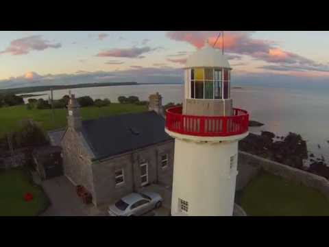 Gold Coast and Ballinacourty Lighthouse at sunset.