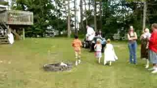 Barry pulling bride and Grandkids on Tractor