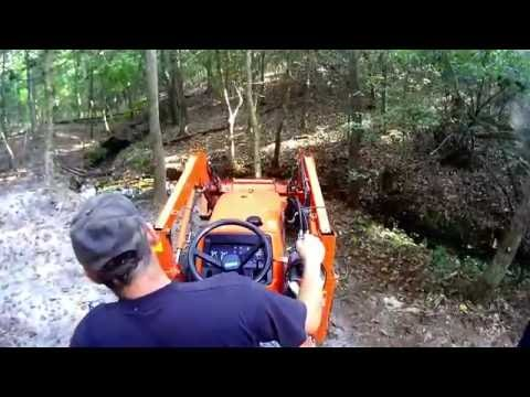 digging a small fish pond with the Kubota tractor