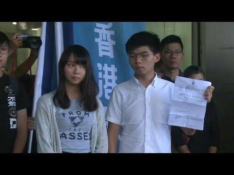 Hong Kong activist Joshua Wong leaves court after arrest   AFP