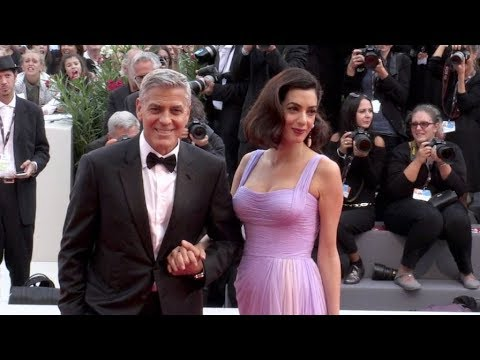 George Clooney and his wife Amal on the red carpet for the Premiere of Suburbicon
