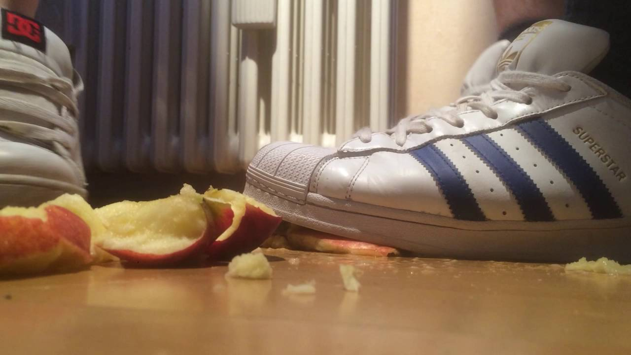 Jana crush apples with her Adidas Superstar white blue