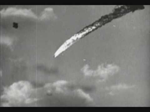 Kamikaze being shot down by 5 inch guns.