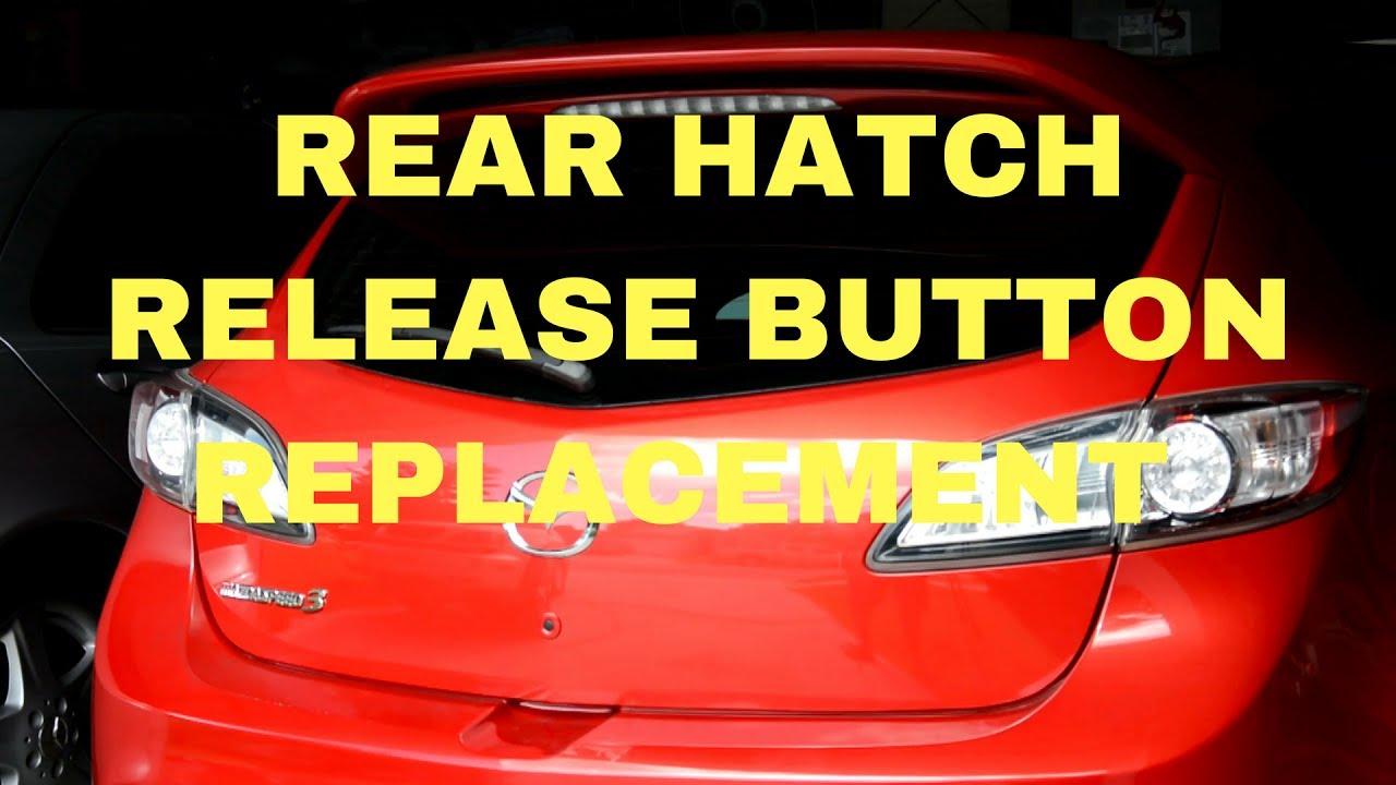medium resolution of 2009 2013 mazda 3 hatchback hatch release button replacement
