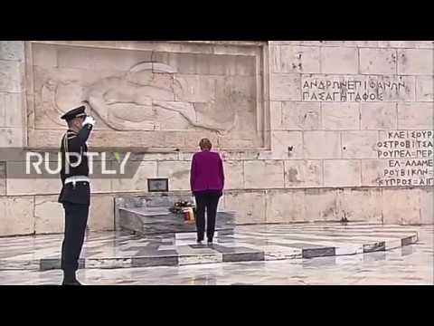 Greece: Merkel lays flowers at Athens war memorial