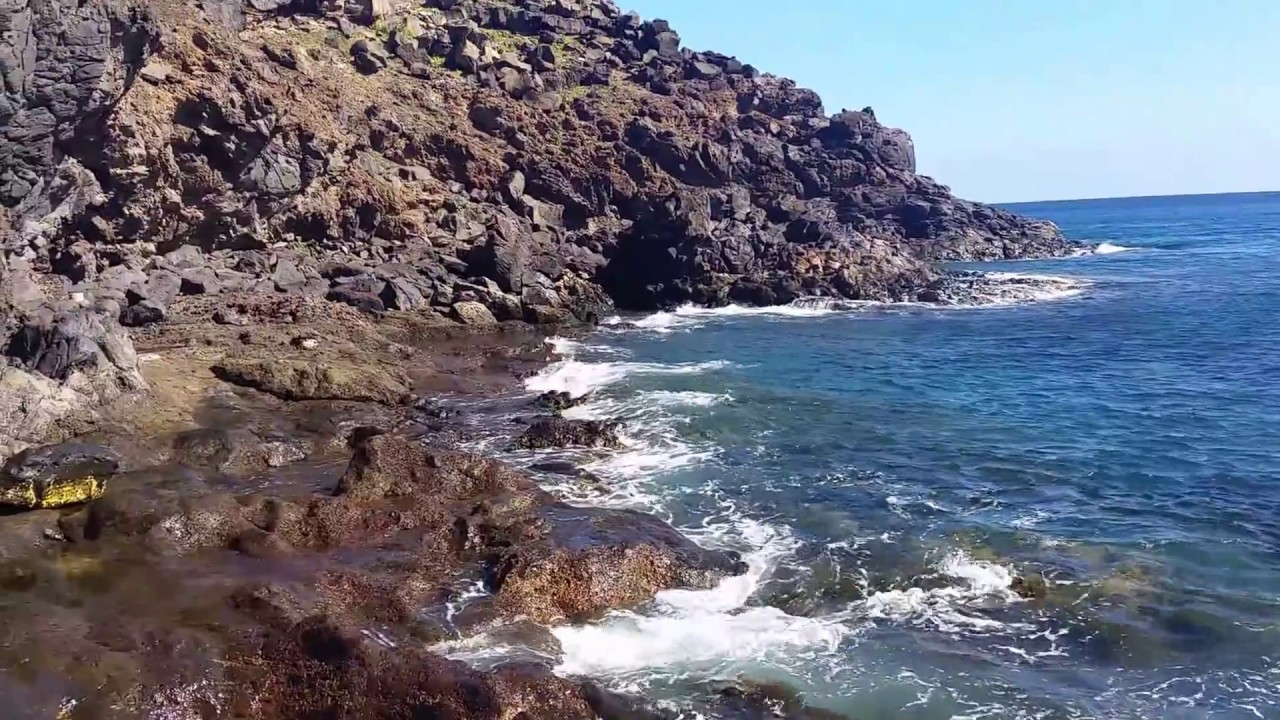 waves crashing in puerto del carmen to puerto calero walk - YouTube