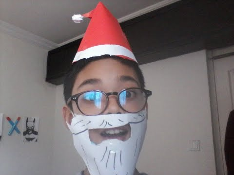 How to make an easy paper Santa Claus beard and a Christmas hat.
