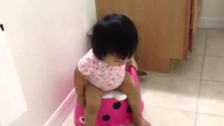 Toddler playing and practicing potty train