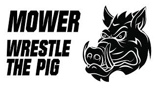 Watch Mower Wrestle With The Pig video
