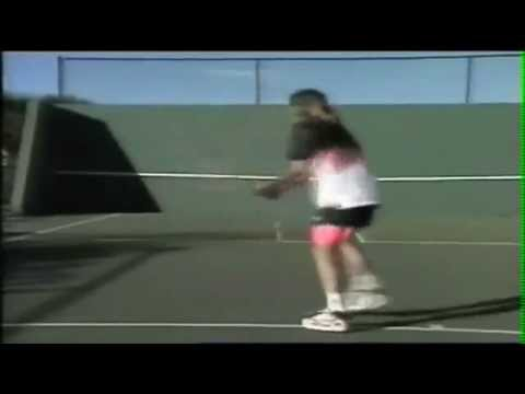 Young Andre Agassi practicing on a wall. Awesome skills!!