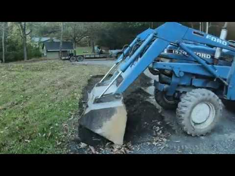 digging-a-drainage-swale-on-the-edge-of-a-driveway