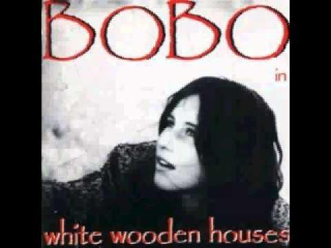Bobo in white wooden Houses  Hole in Heaven