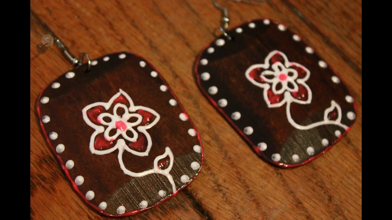 of hand mari earrings ar cloth made pin with rubenian painted