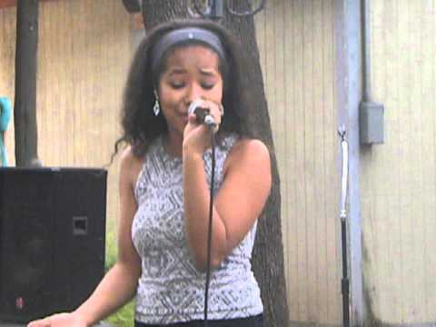 Mia Dean sings