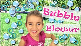 Funny Kids and Bubble Blower. Friends play on Big playground