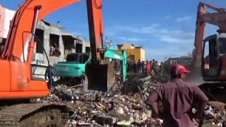 Raw: Search For Indonesia Earthquake Survivors