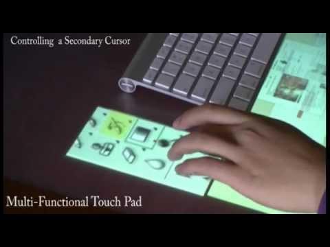 Magic Desk: Bringing Multi-Touch Surfaces into Desktop Work
