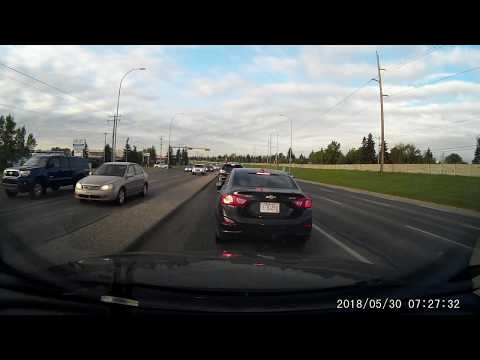 Lady caught on Camera littering on the road TWICE - Calgary License plate: E-01250