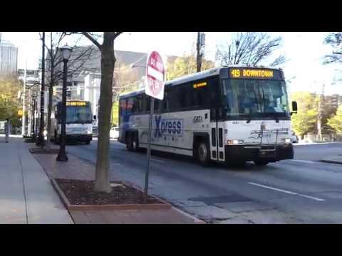 GRTA Xpress: 2006 MCI D4500CL Route 419 & 463 Buses #4007 #4014 at Ted Turner Dr-Ivan Allen Jr Blvd