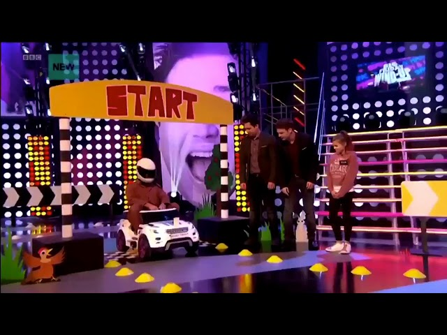 Rye Beaumont driving a car at the CBBC show