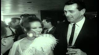 Milton Rackmil presents bouquet to actor and film maker Claudia Cardinale during ...HD Stock Footage