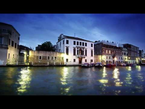 Stationary shot of waterside buildings on the Grand Canal