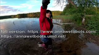 WetLook 203 girl in wet shorts and rubber boots in deep water