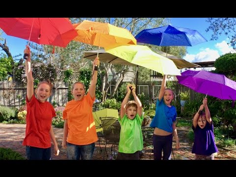 Thumbnail: Learn English Colors! Rainbow Umbrellas! It's Raining Water Balloons with Sign Post Kids!