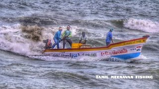 A Boat surfing in  angry waves at Bay of Bengal