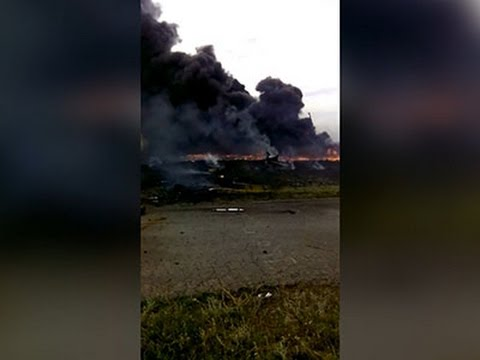 Raw: Video Captures MH17 Crash Aftermath