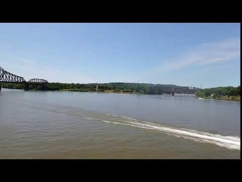 a daytime summer aerial establishing shot of an ohio river jet skier
