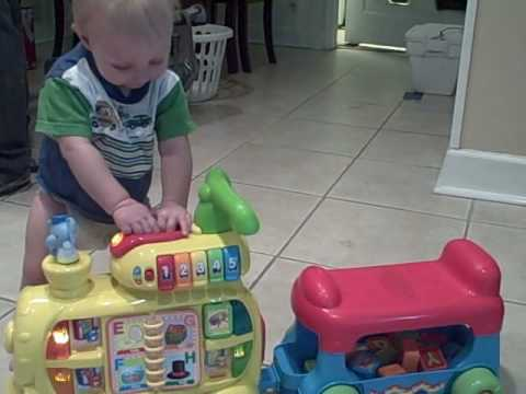 Eli playing with his new train