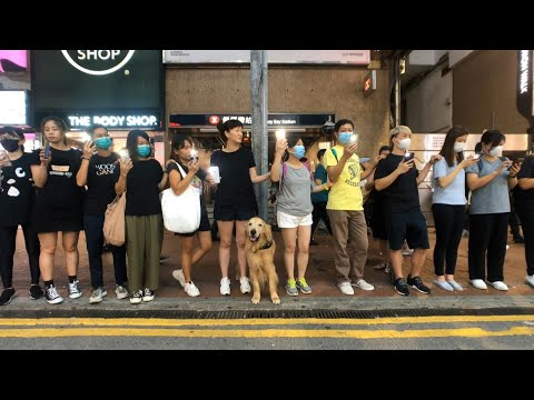 hong-kong-pro-democracy-protesters-form-human-chain-|-afp