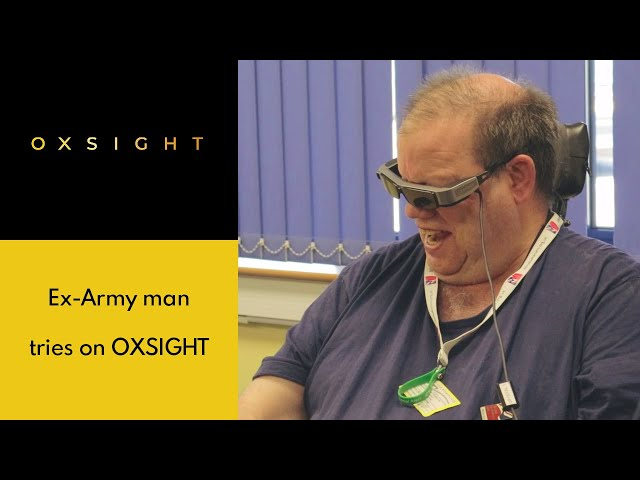 Jeff, former British Army, tries on OXSIGHT glasses at Deafblind UK