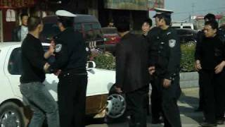 Useless Cop Gets Beat Up in China