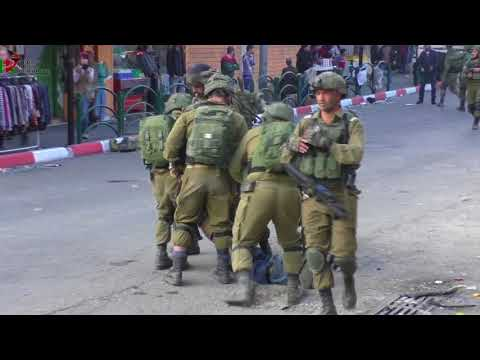 The Israeli army brutally assaults a young man in Hebron during the march of the jewish settlers