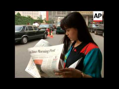 China - Murdoch Signs People's Daily Deal