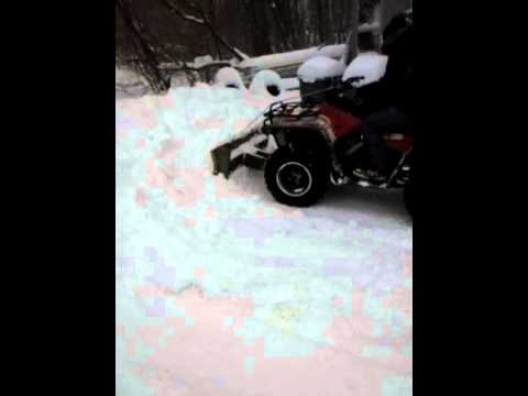 DIY wood snowplow for ATV testing it out part 2of2