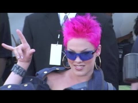 singer pink arrives with pink hair i m taking over the world and