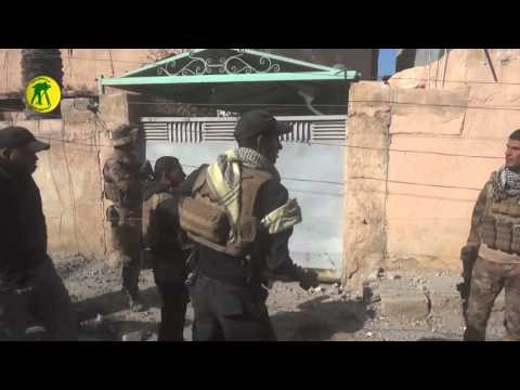 Iraqi security forces clearing the poultry district in Ramadi