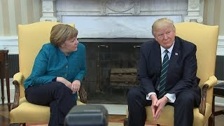 Trump​ appears to ignore requests for a handshake with Angela Merkel​ thumbnail