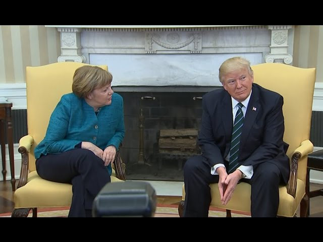Trump appears to ignore requests for a handshake with Angela Merkel