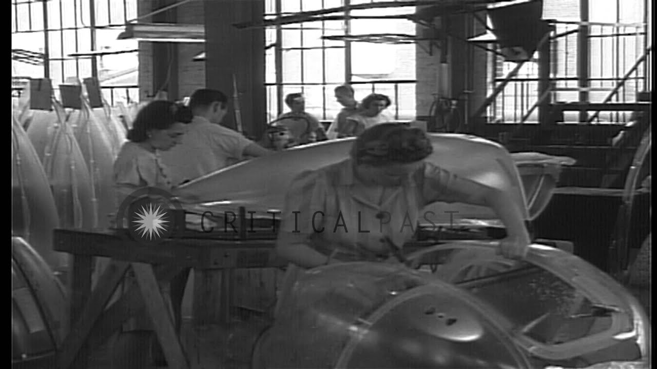 Men and women work in an aircraft canopy manufacturing plant in the United States...HD Stock Footage - YouTube & Men and women work in an aircraft canopy manufacturing plant in ...