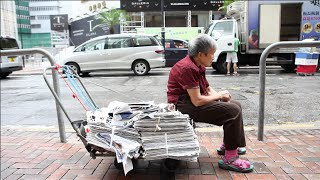 Collecting for rent in pricey Hong Kong, one cardboard box at a time