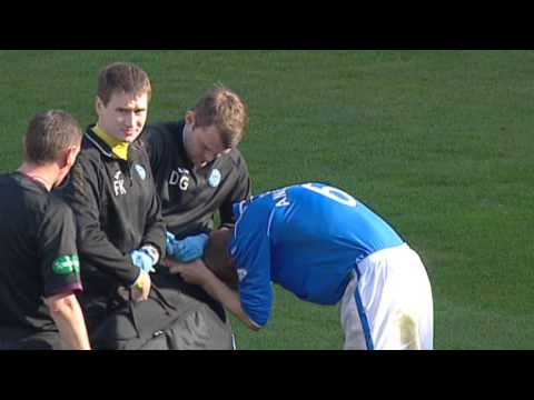 Not for the faint-hearted! Steven Anderson squirms in pain following injury