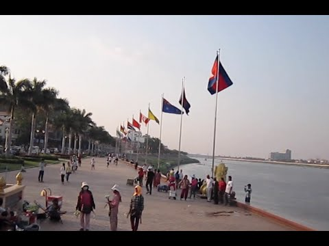Walking along the riverside in Phnom Penh city in the afternoon