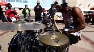 Drummer J-Star shows kids how to beat the streets